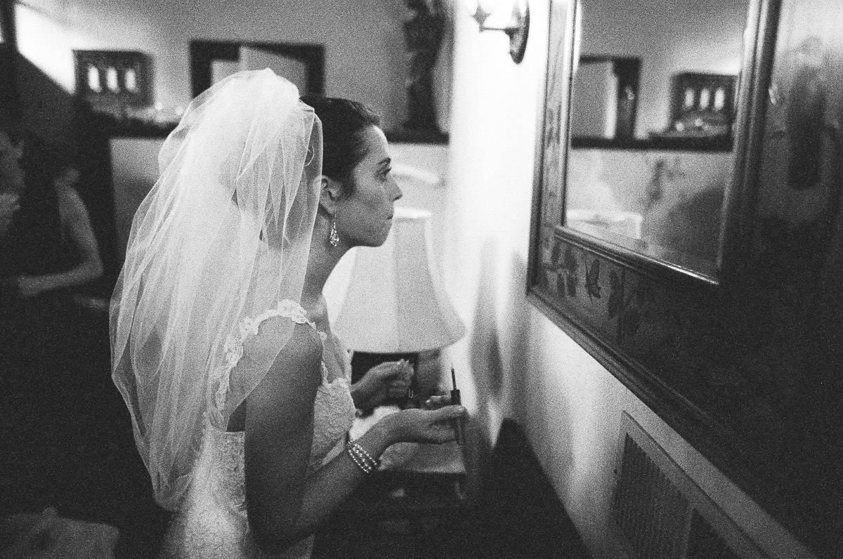 Bride fixing her makeup