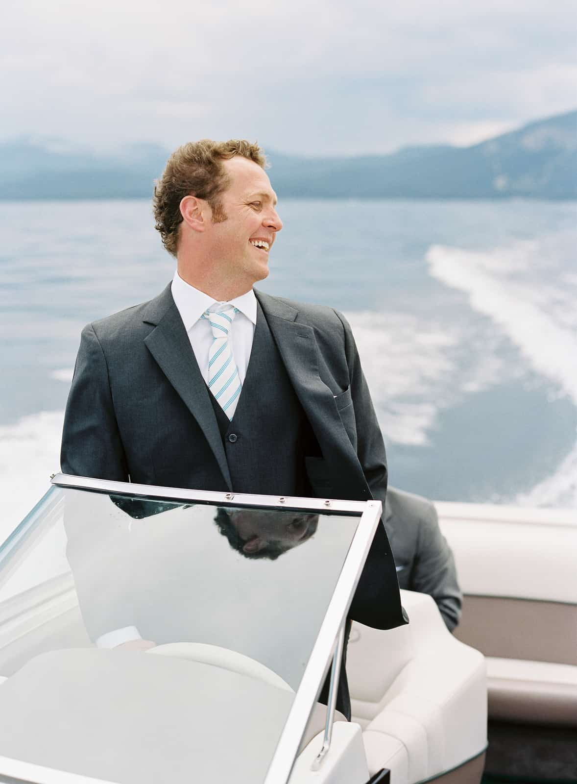 Groom driving a boat to the ceremony