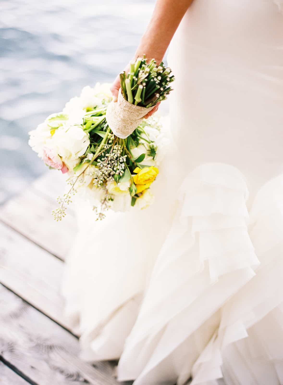 Rose and ranunculus bouquet with Vera Wang dress