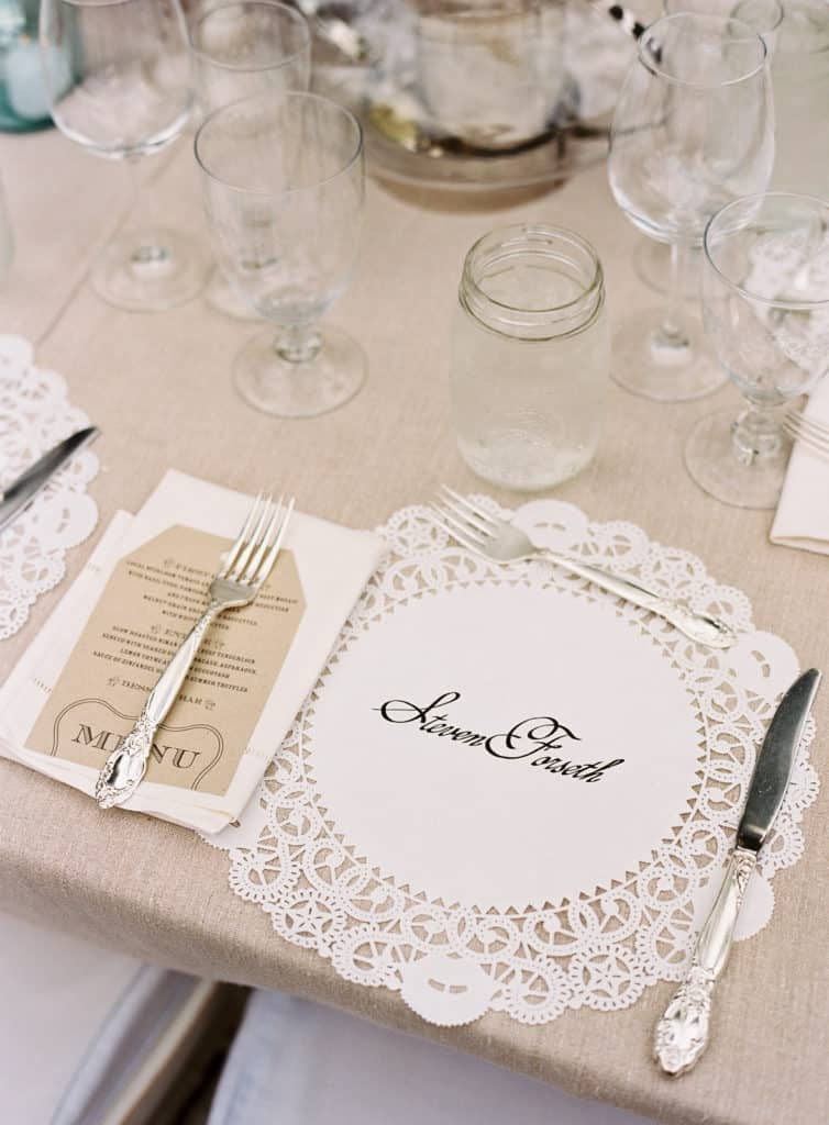 Dinner place setting with hand lettered doilies