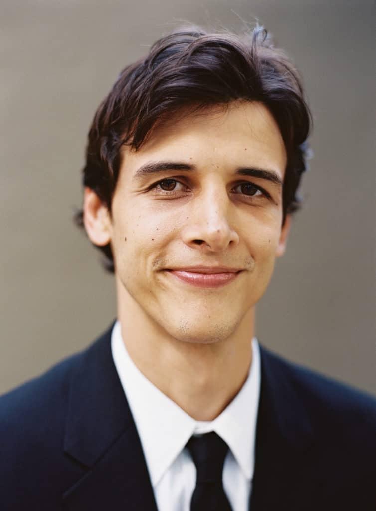 Groom in black suit
