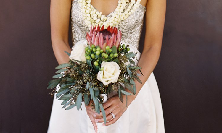 Bride portrait with protea bouquet and lei