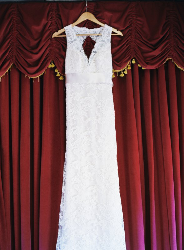 Monique Lhuillier wedding dress on a hanger