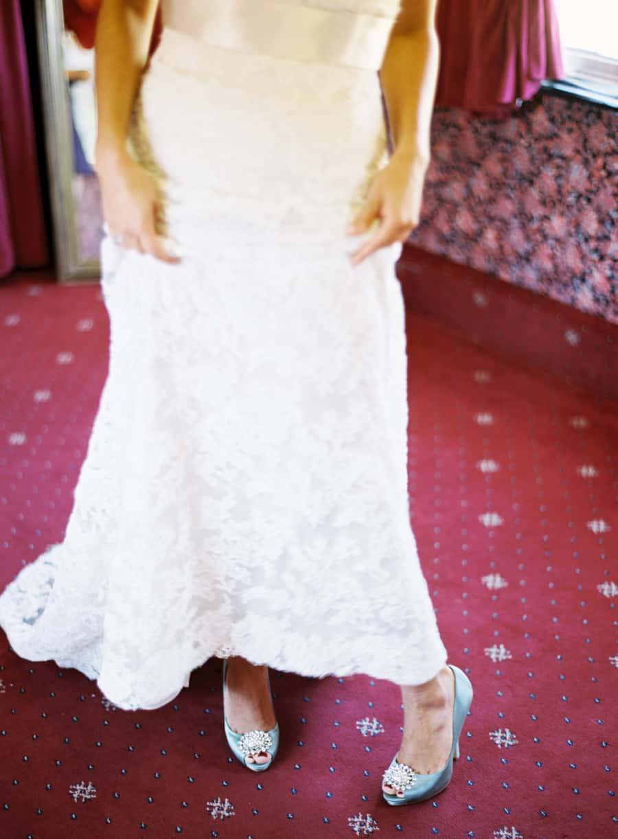 Bride showing off her Badgley Mischka shoes