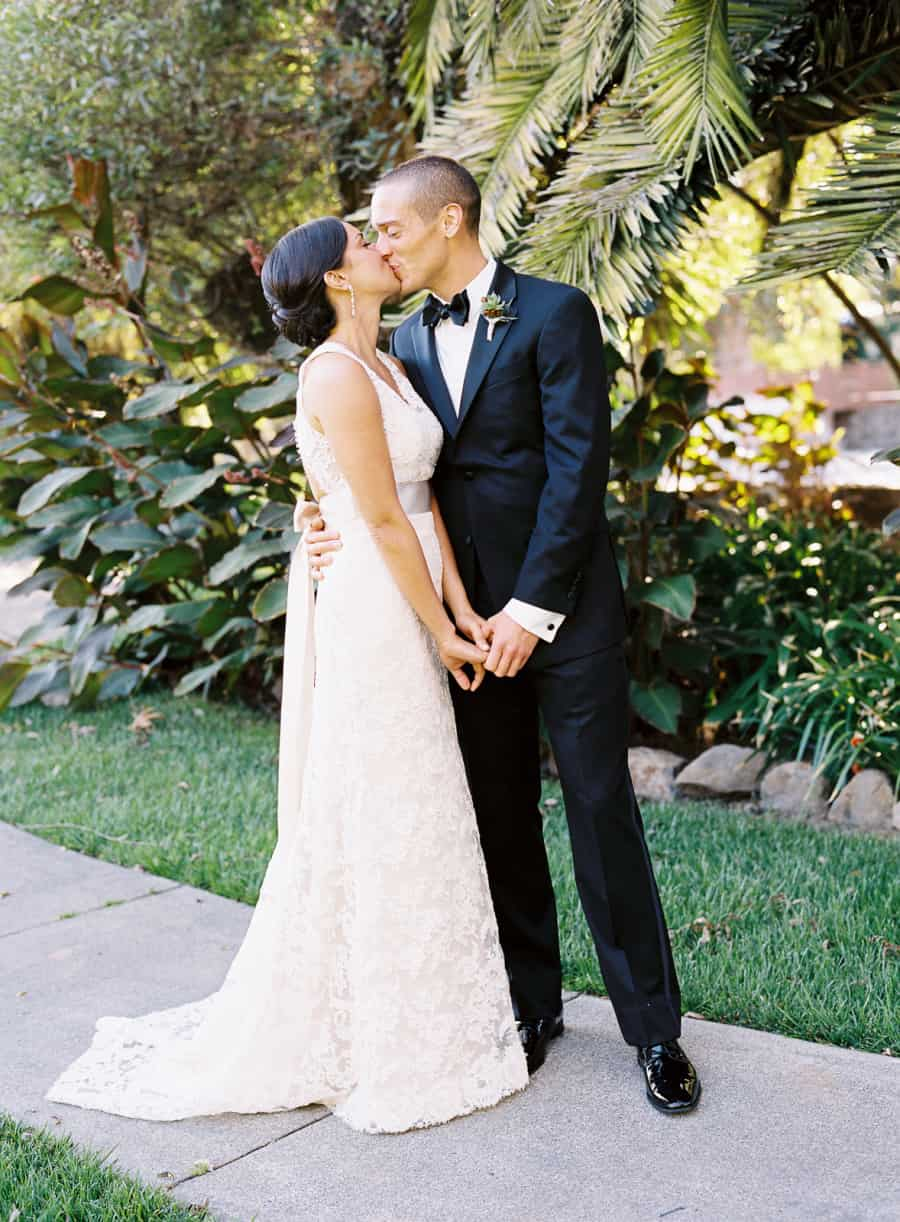 Newlyweds kissing and holding hands