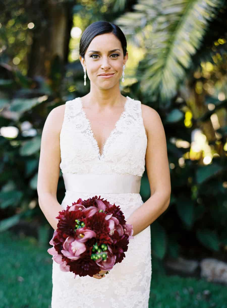 Bride portrait with maroon bouquet