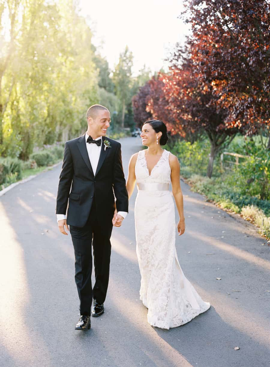 Wine country wedding portrait of couple walking