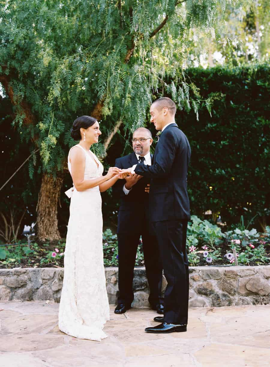 Couple exchanging rings during ceremony