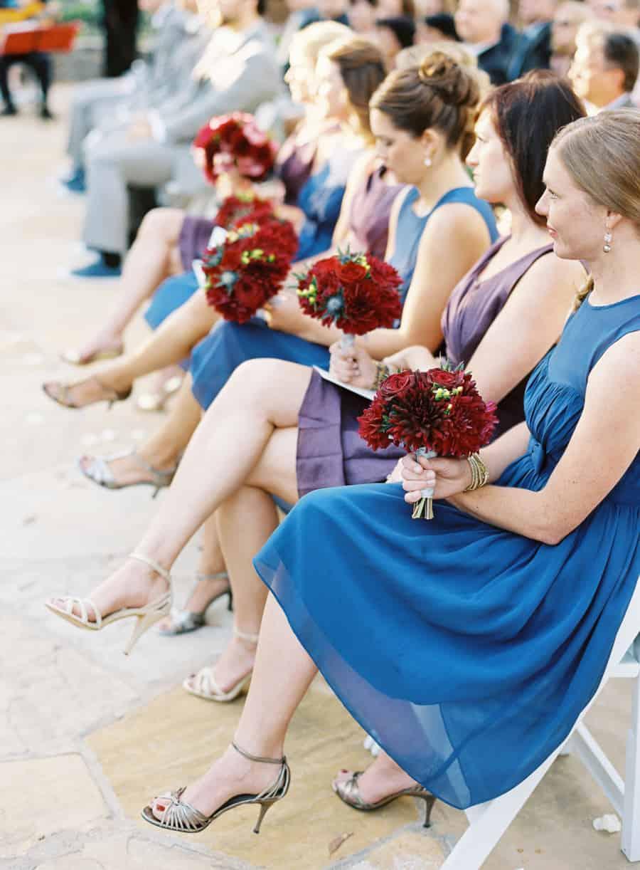 Bridesmaids in alternating dresses