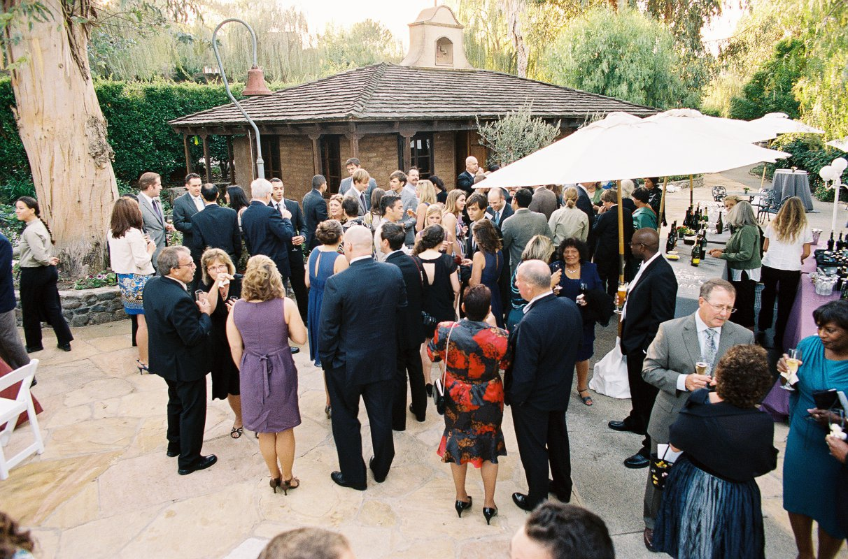 Cocktail hour in front of adobe house