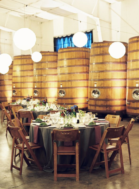 Table setttings in front of wine vats