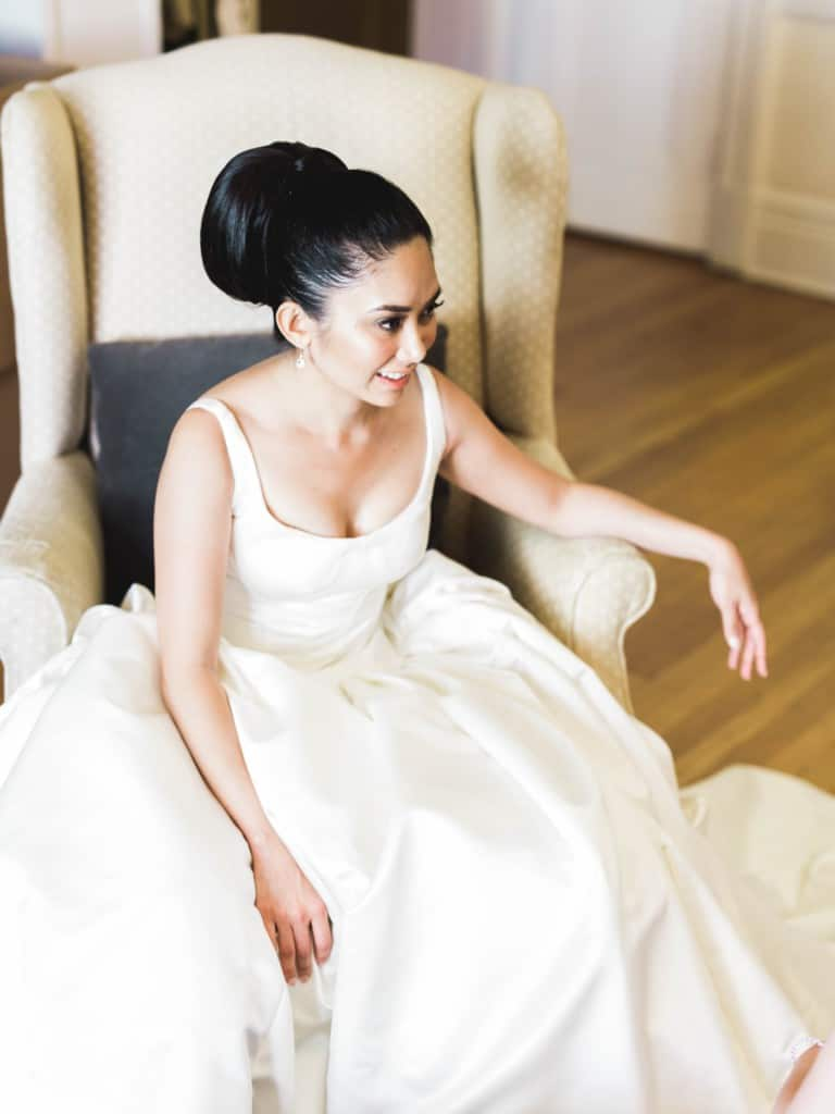 bride siting in armchair