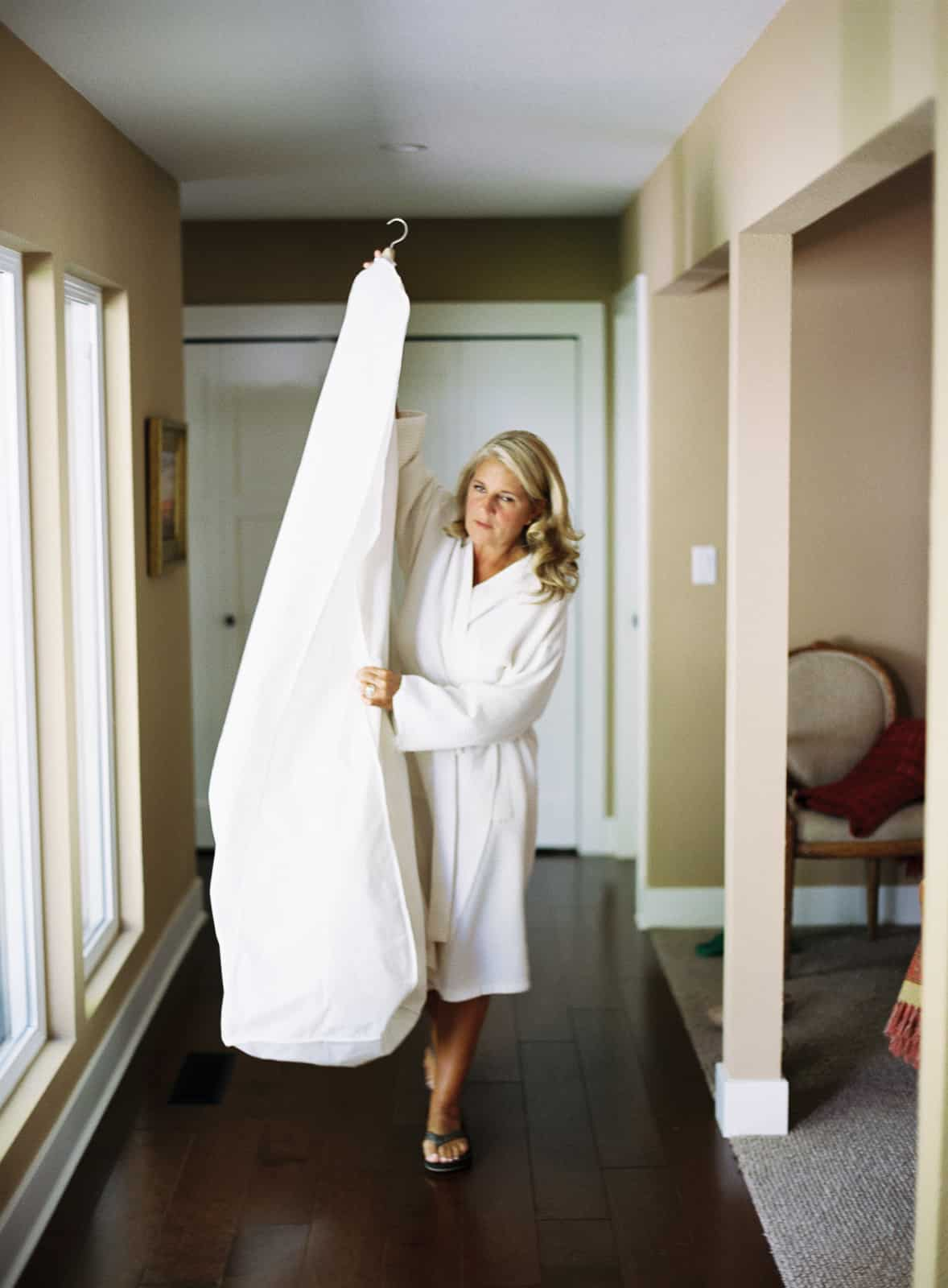 Mother carrying wedding dress