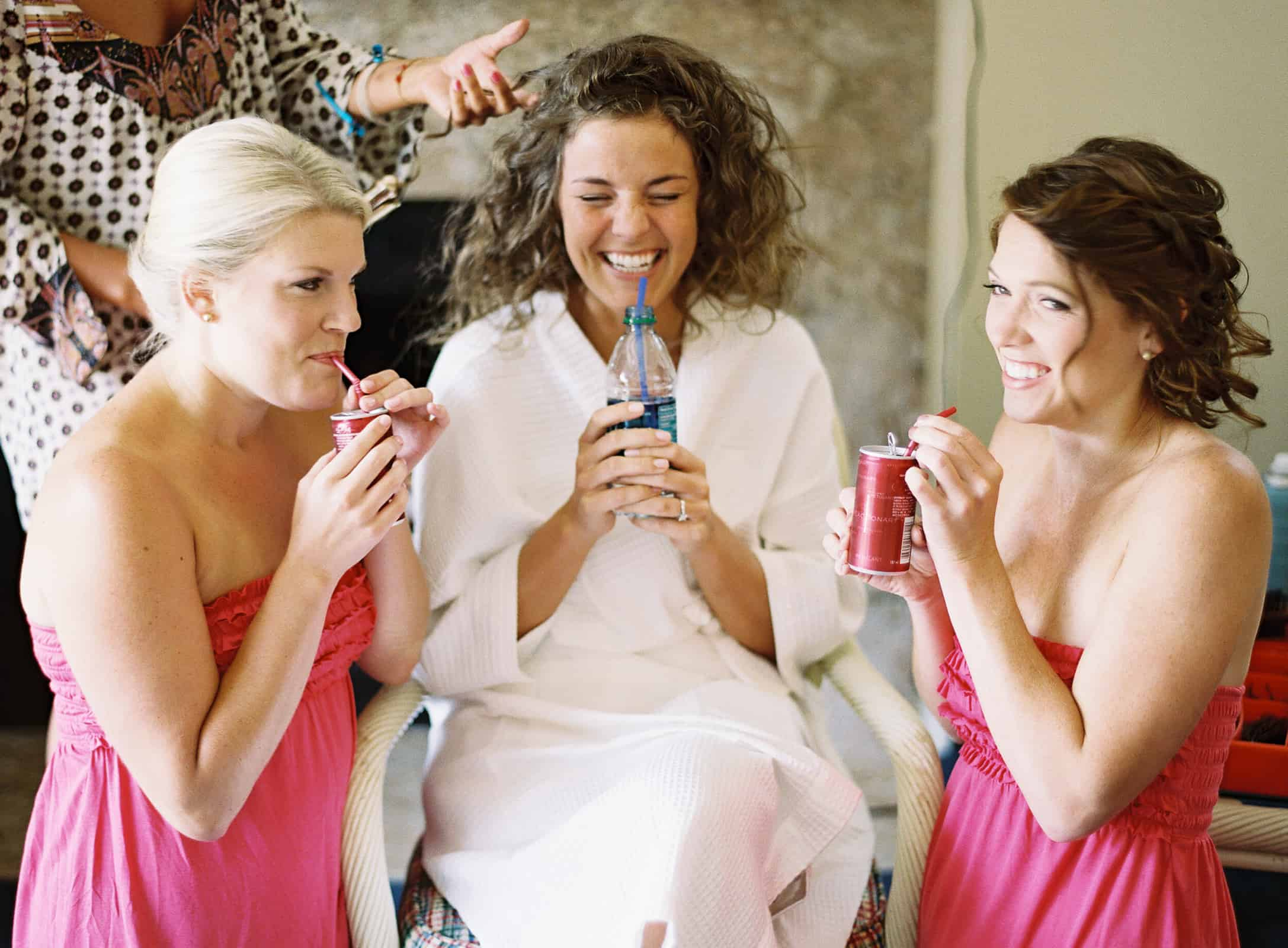 bridesmaids with straws