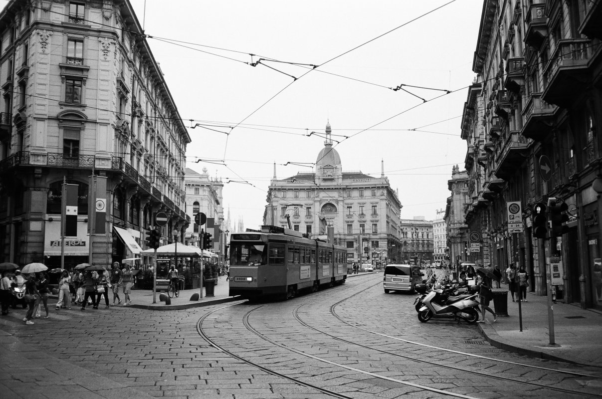 Tram and people walking in central Milan