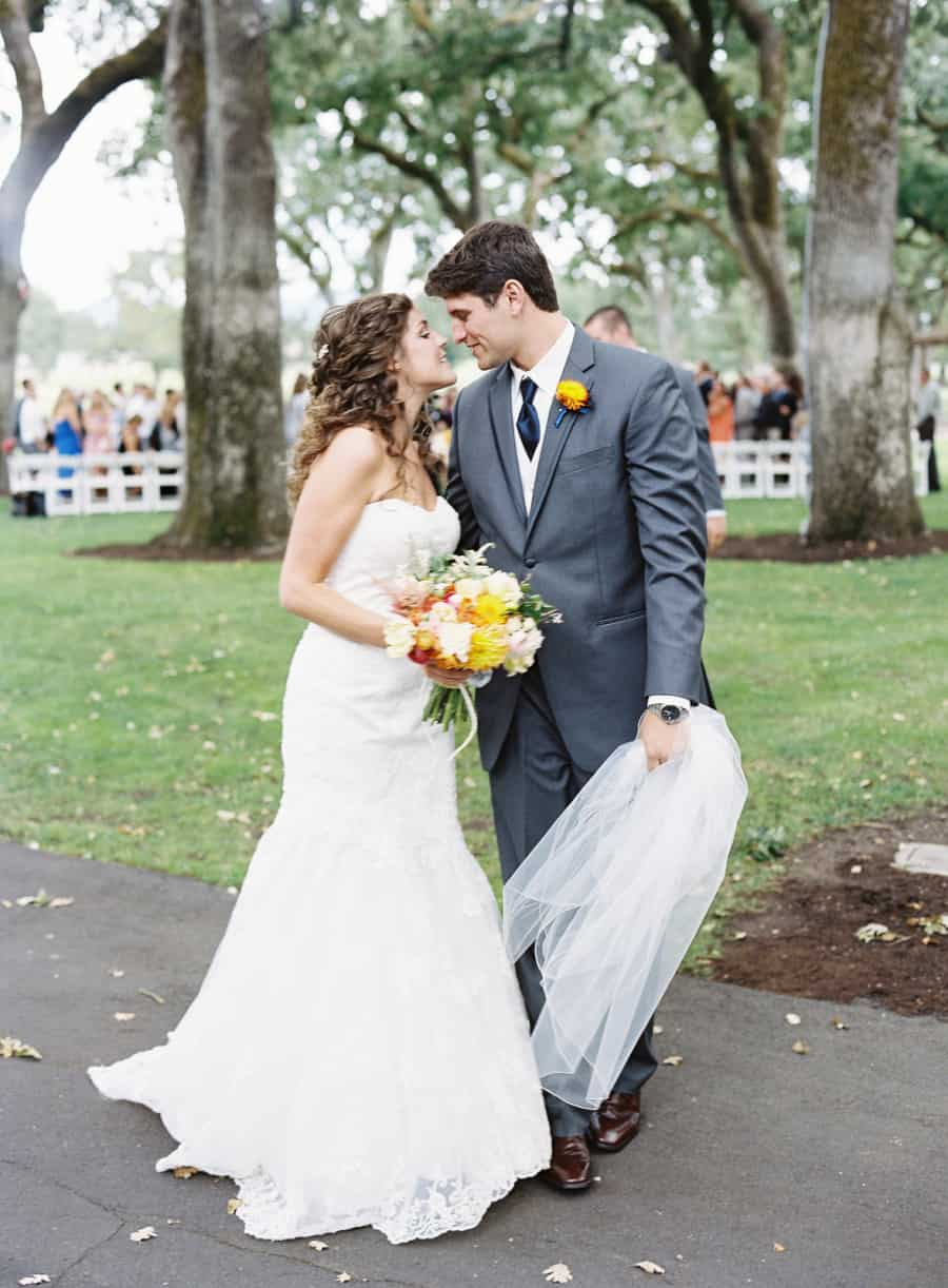 yellow bouquet boutonniere gray suit