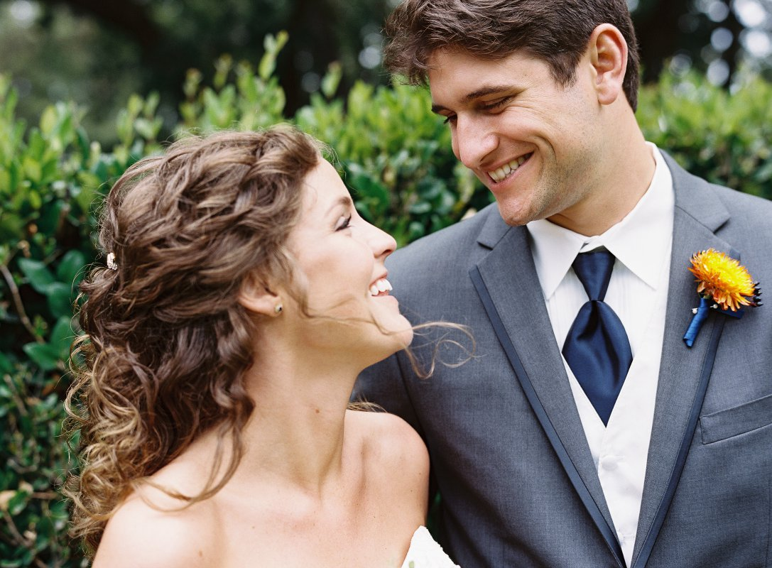 smiling gray blue groom suit