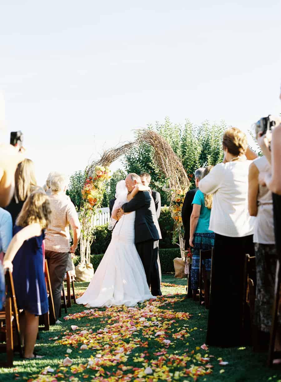 Father hugging bride