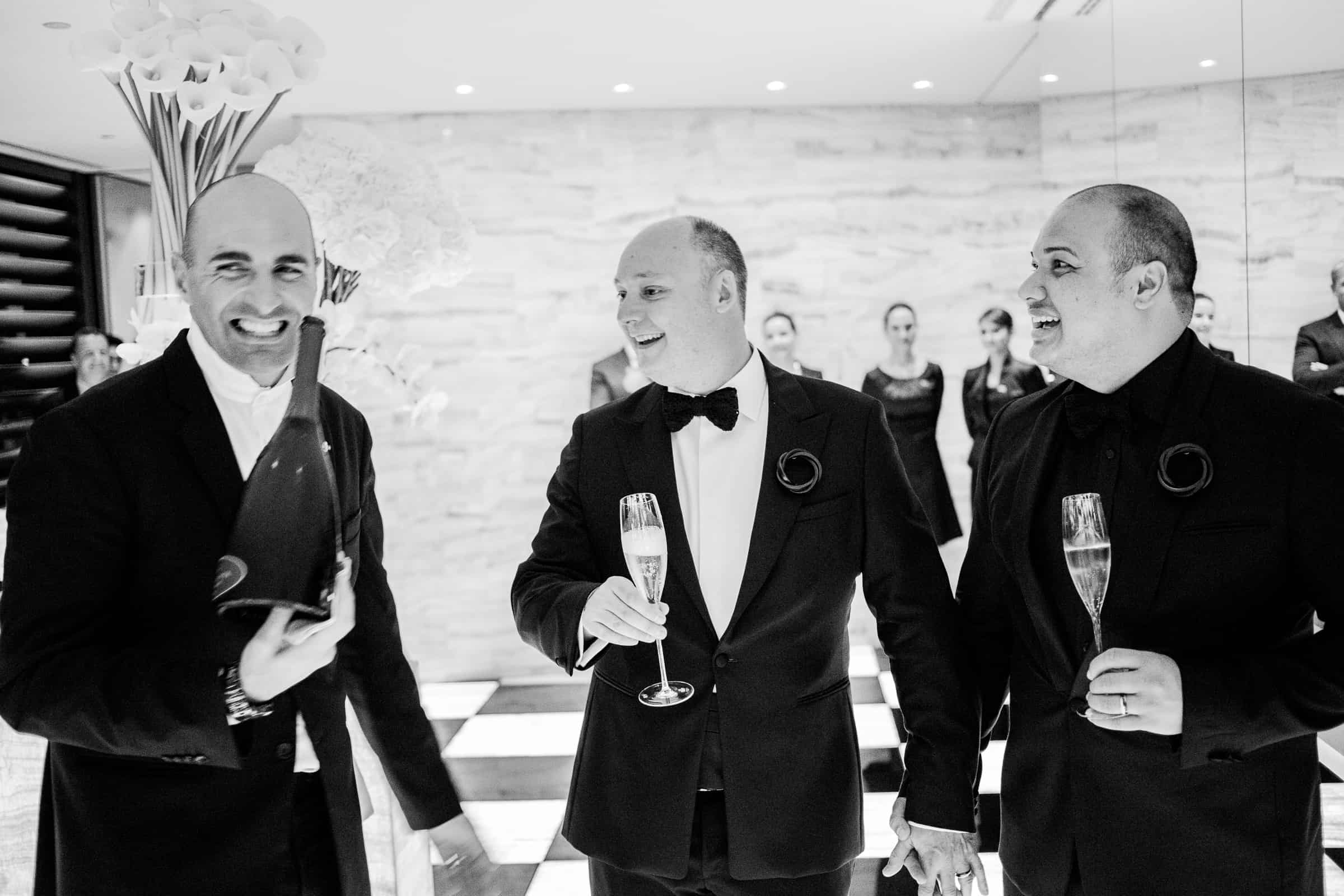 Champagne is served to the grooms