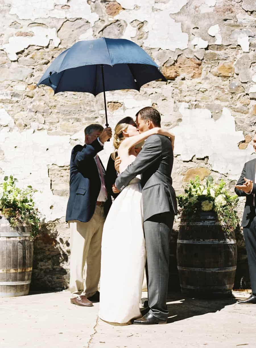 first kiss under umbrella