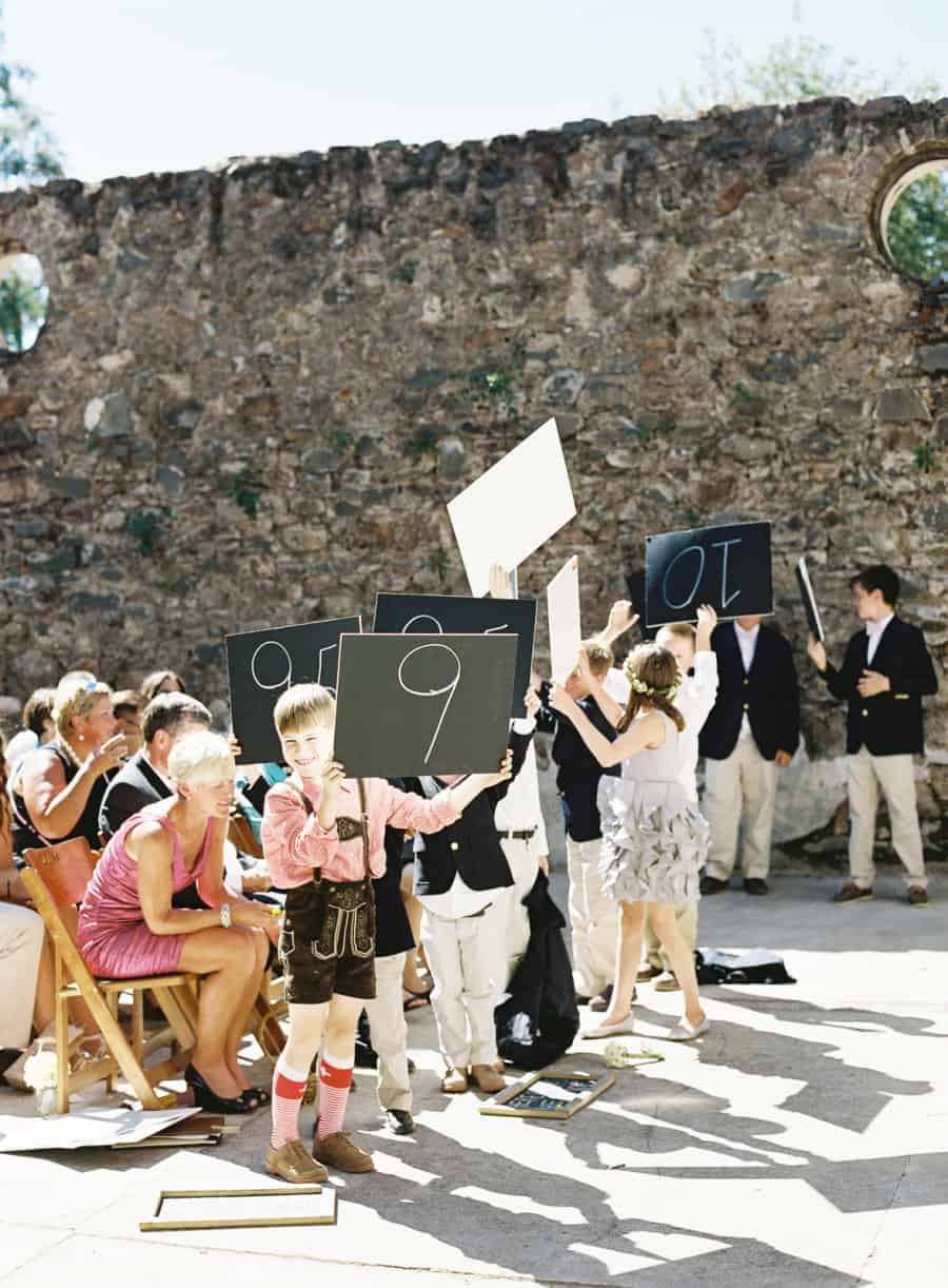 junior wedding party holding score cards
