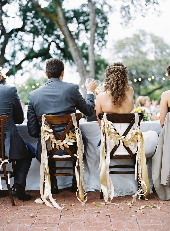 head table chairs decorated with gold leaves