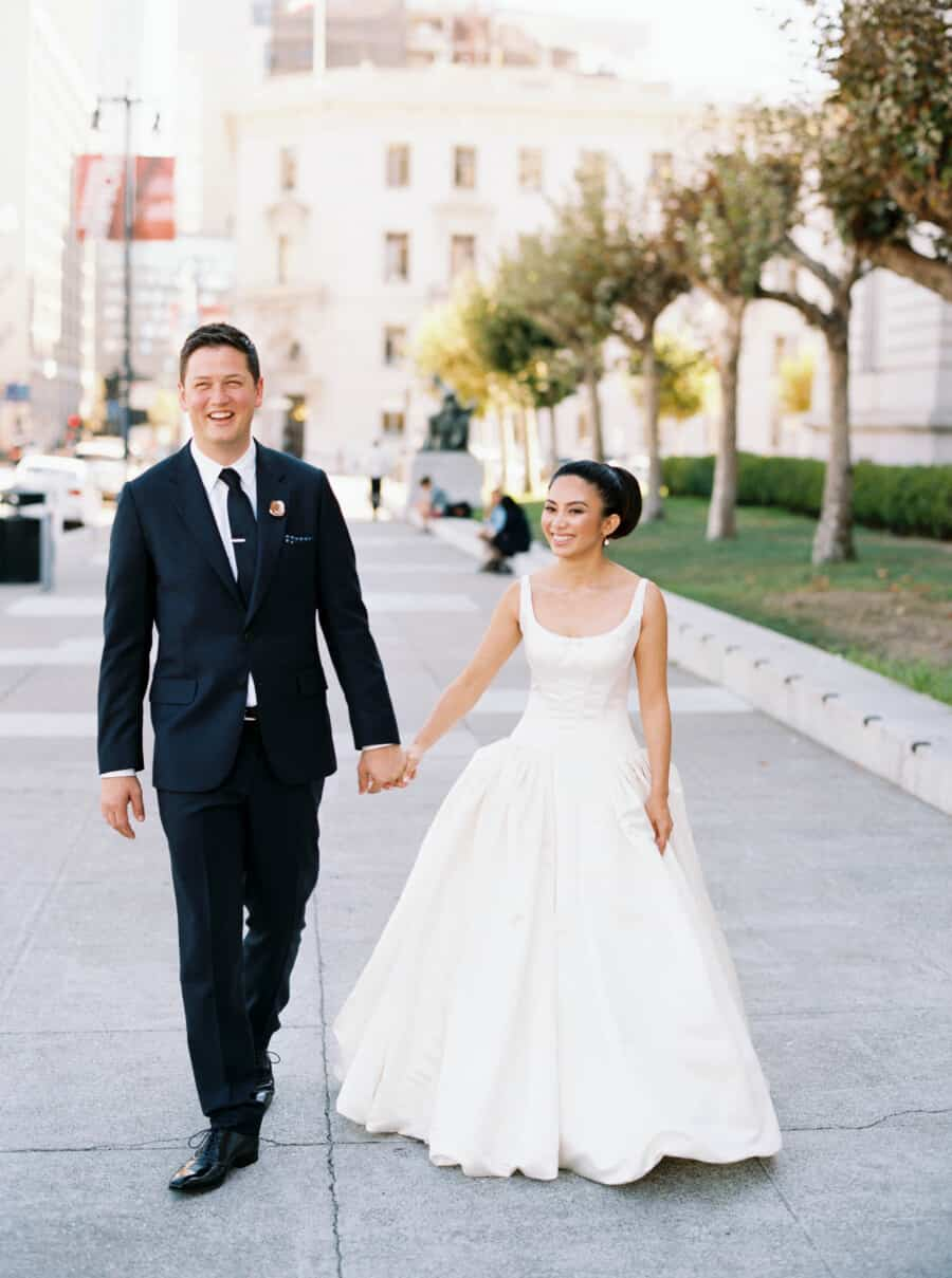 married couple walking on sidewalk