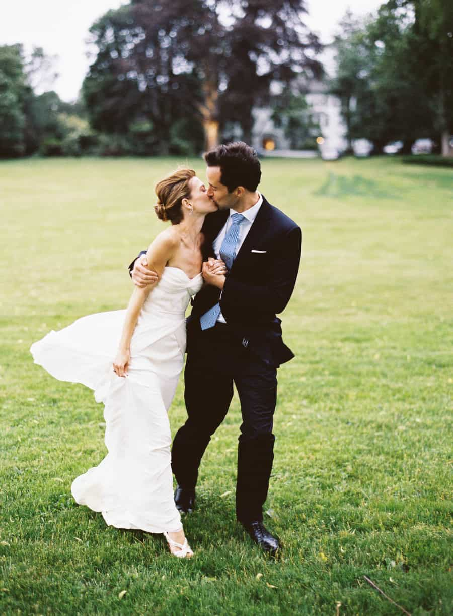 bride and groom waking kiss