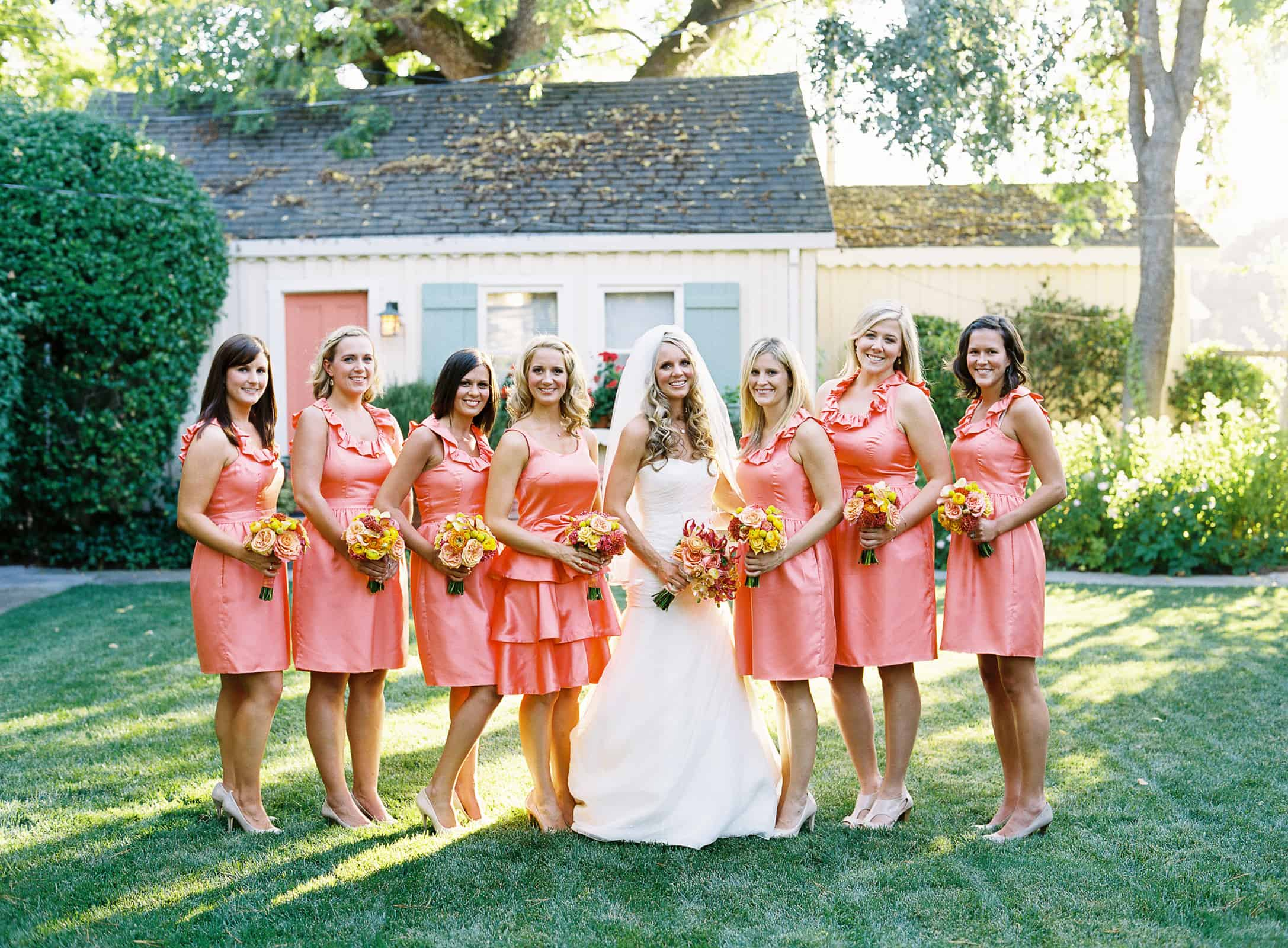 Bride with bridesmaids in peach dresses