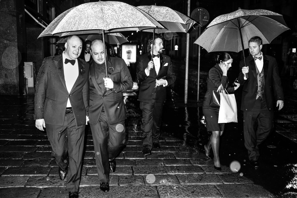 Wedding party walking in the rain