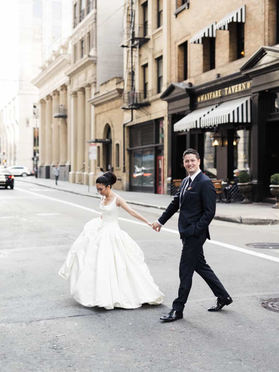 bride and  groom walking in downtown San Francisco