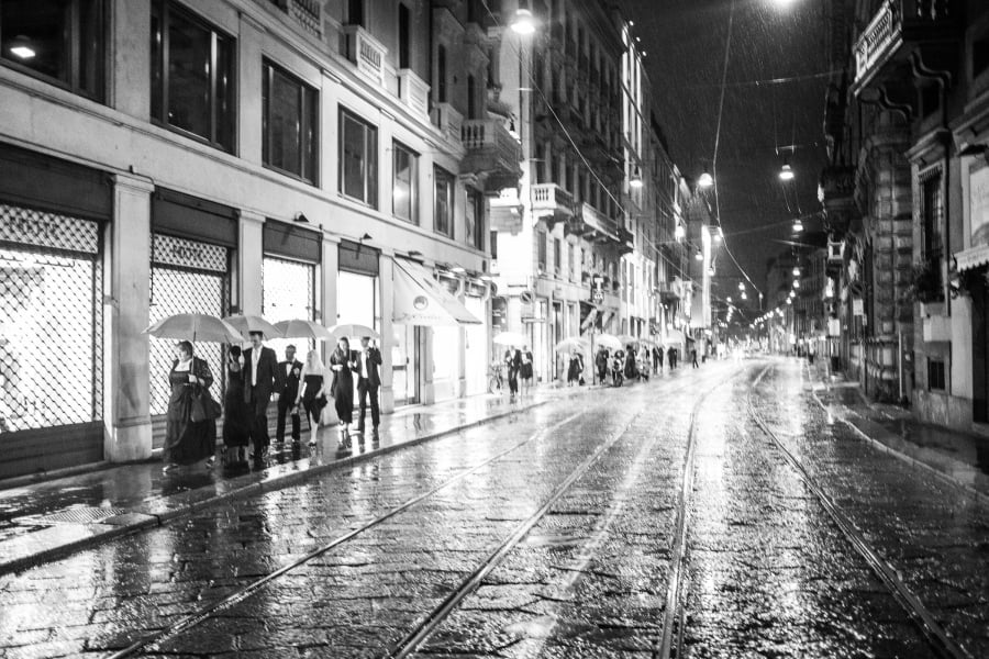 Wedding guets walking down the street in Milan