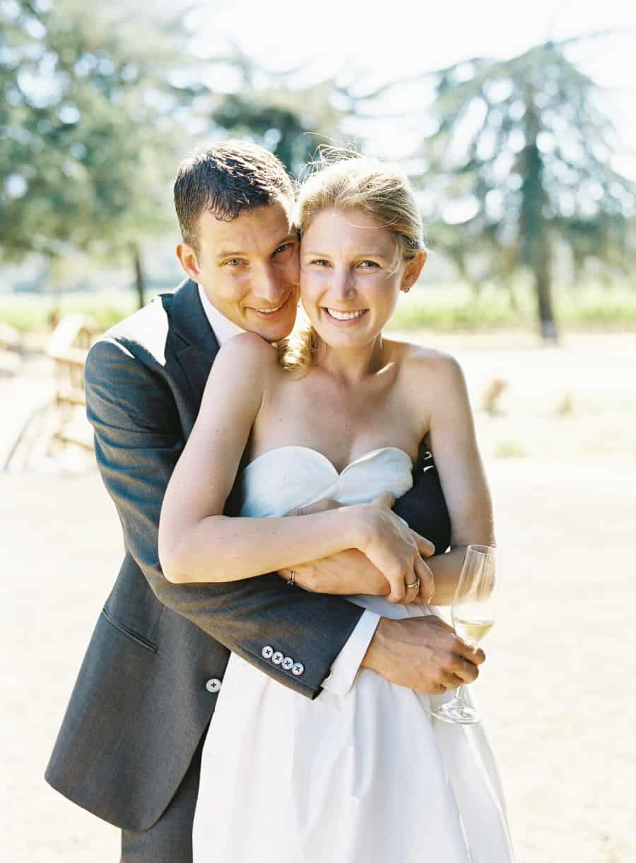 groom holding bride close