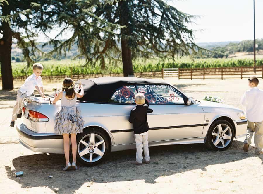 kids decorating getaway car