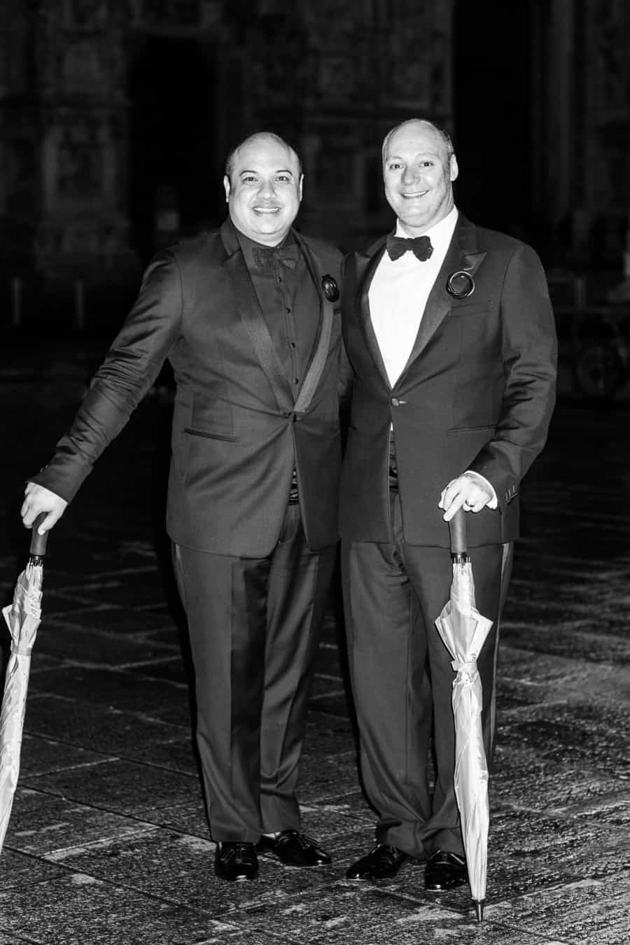 Portrait of the grooms at the end of the night after gay wedding in Italy