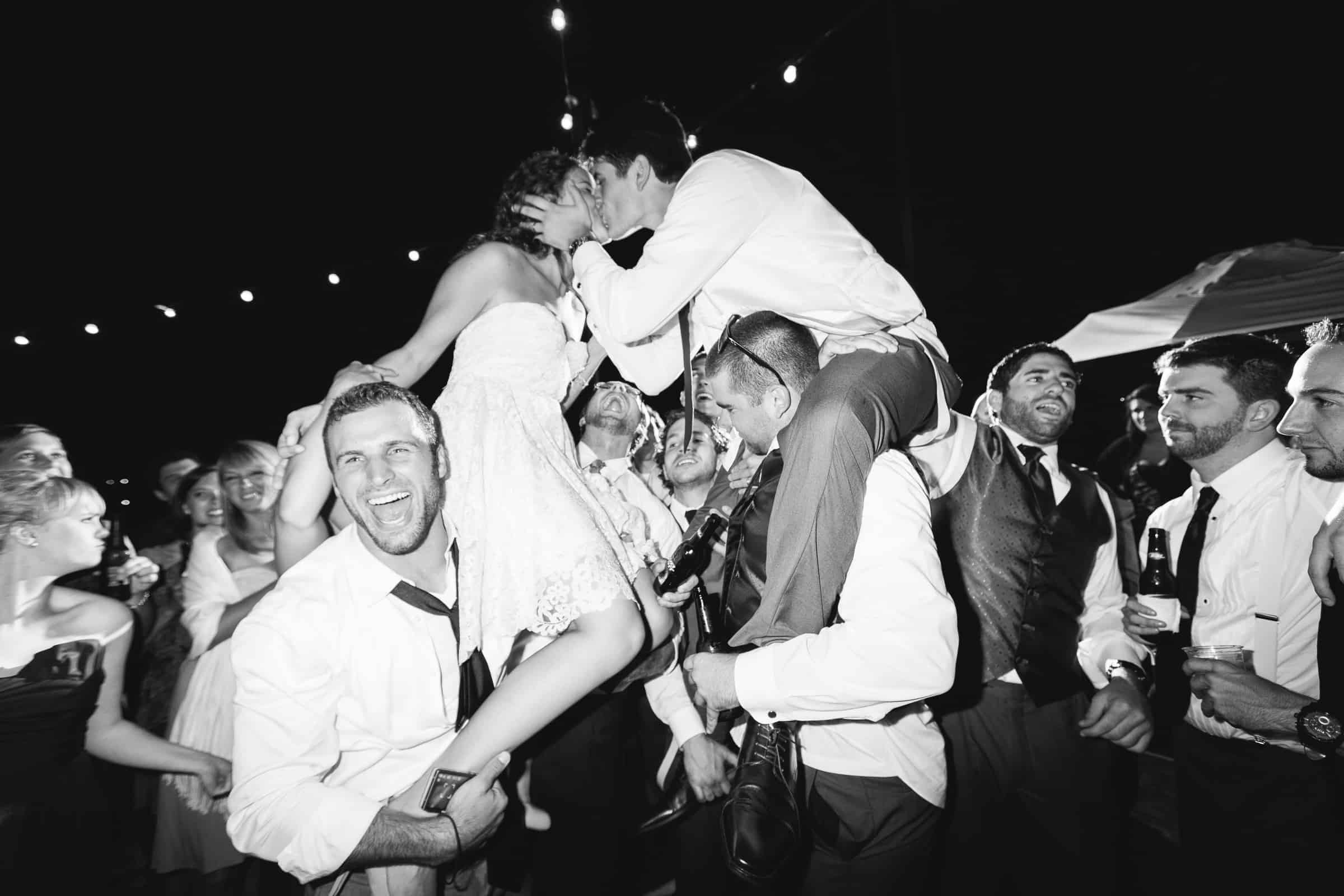 party bride groom on shoulders