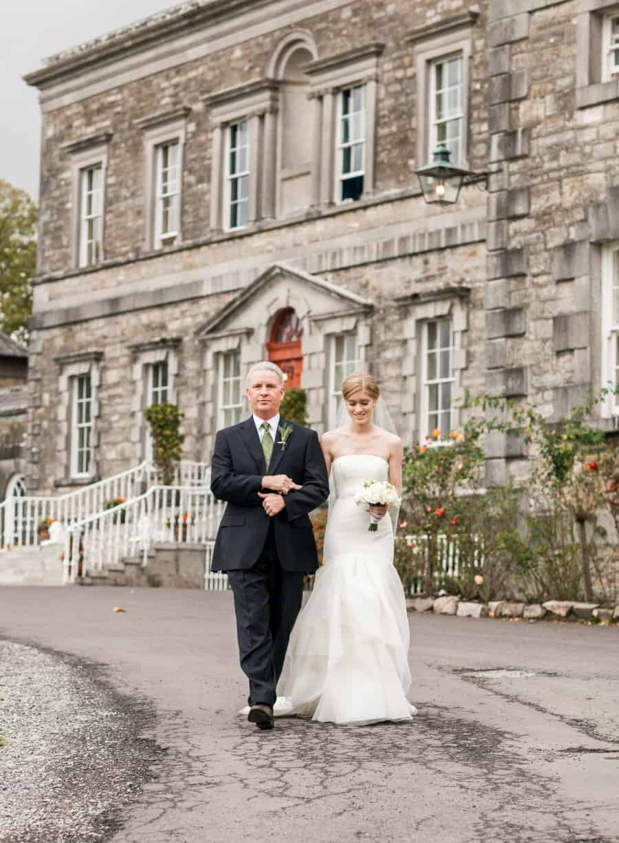 Father walking bride to the ceremony
