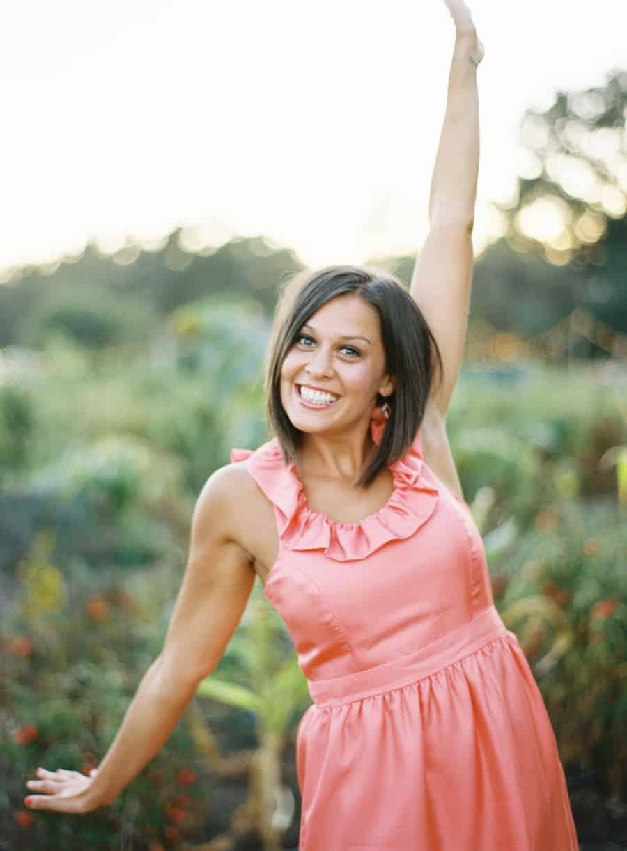 Bridesmaid waving arms