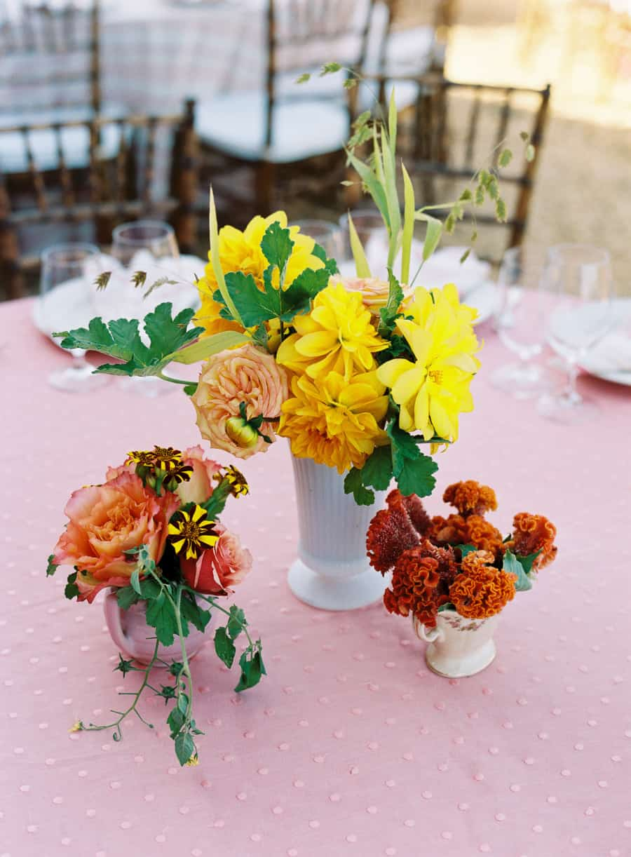 Yellow orange and red flower centerpieces