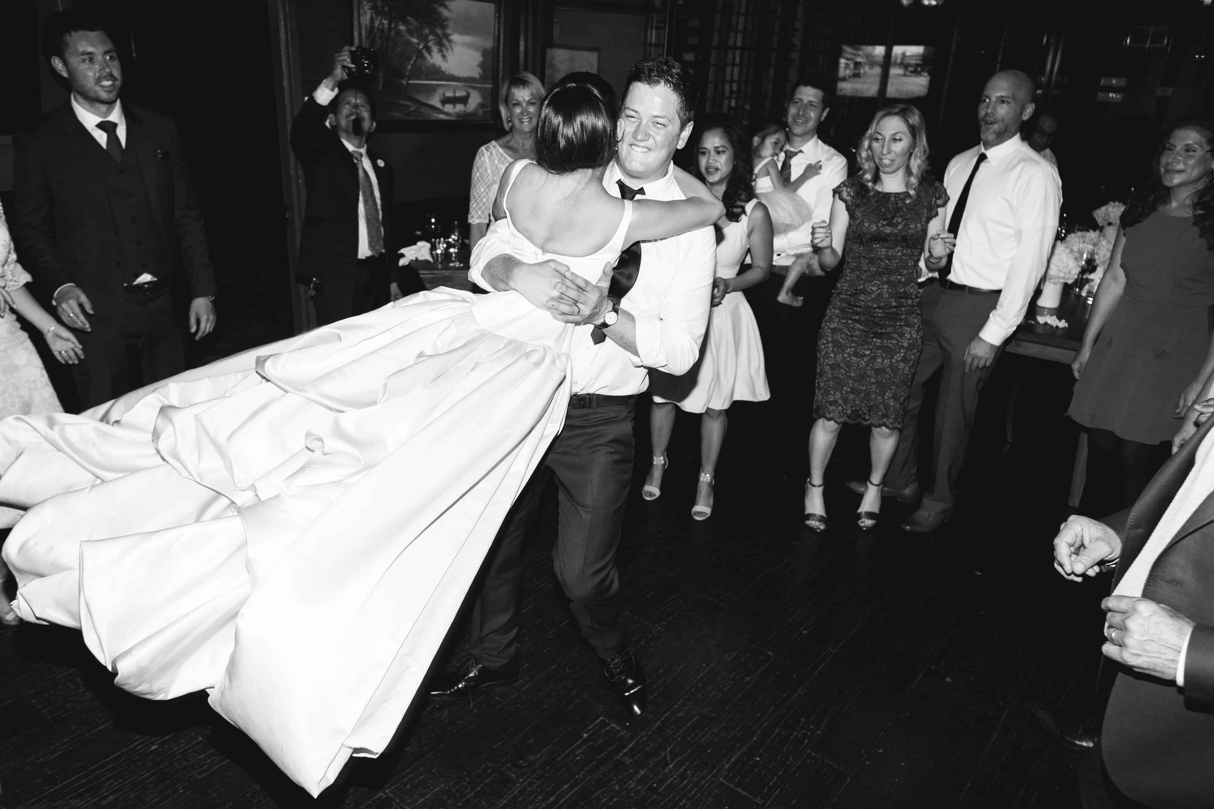 groom swinging bride