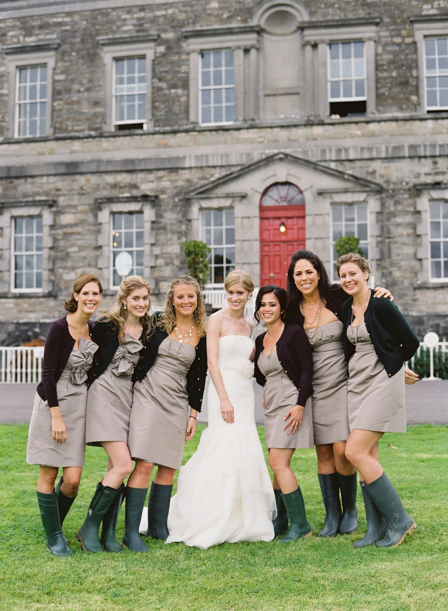 Bride with ridesmaids in wellies