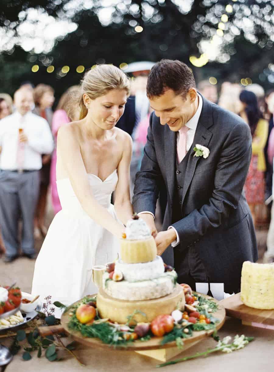 cuting the cheese wheel cake
