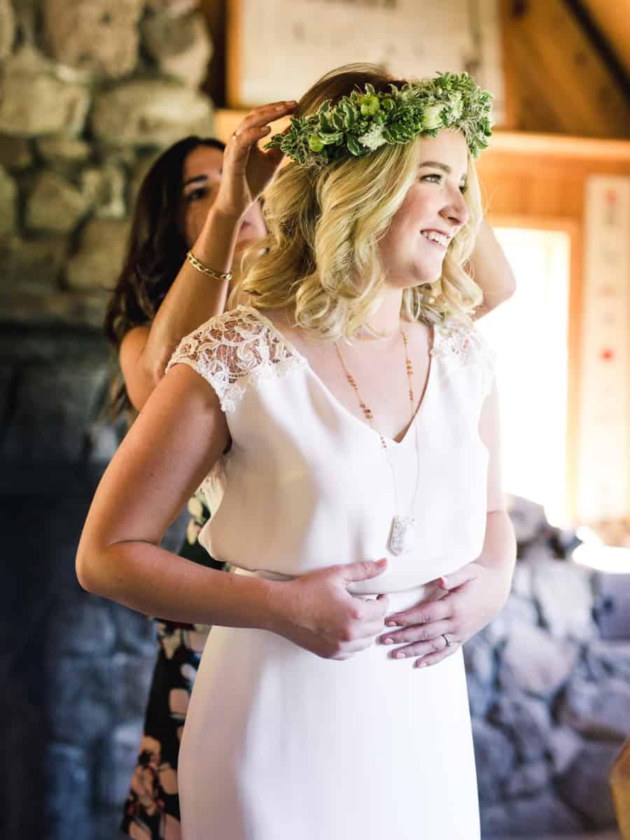 bride putting on green flower crown