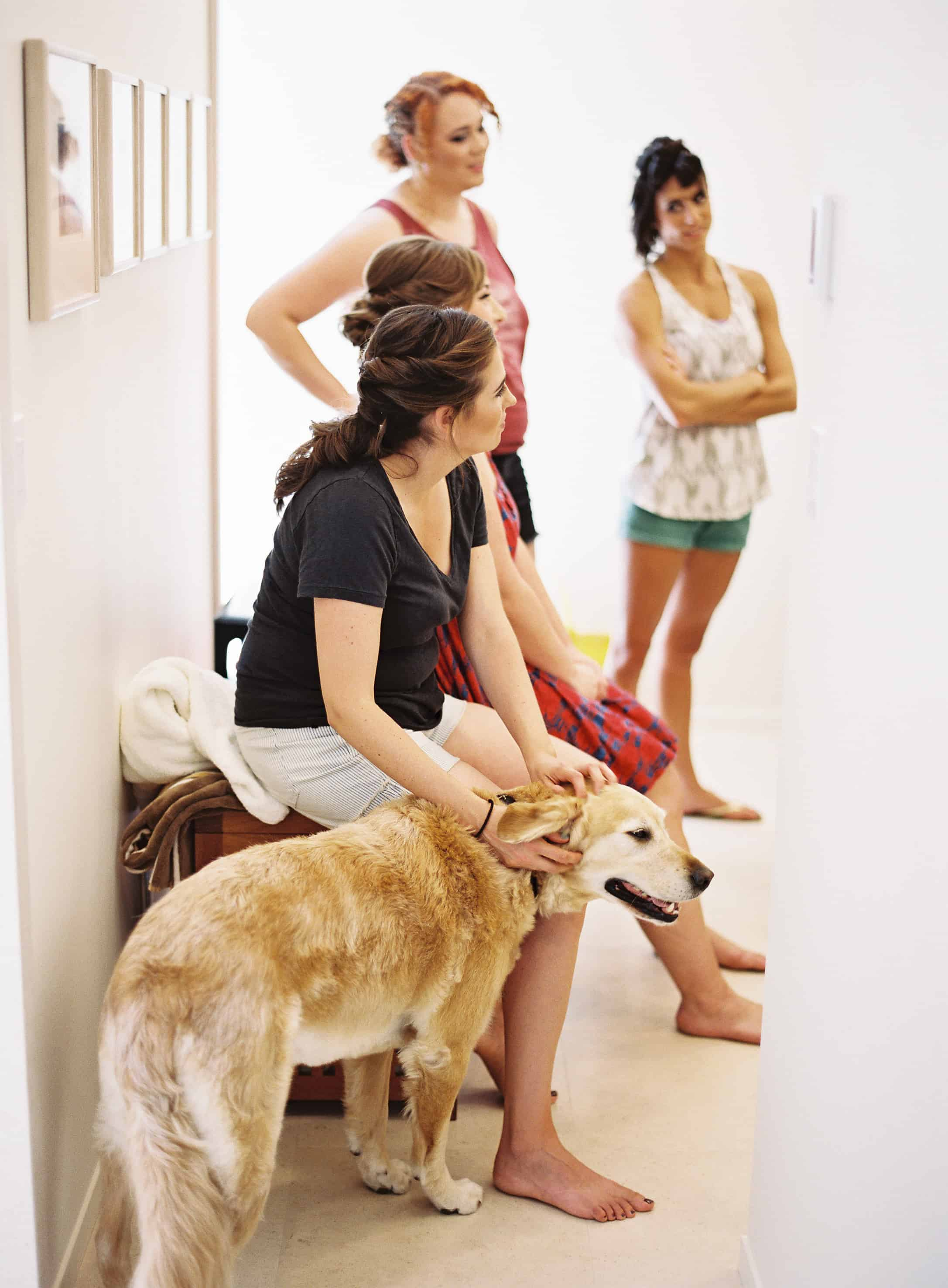 bridesmaids and golden retriever getting ready