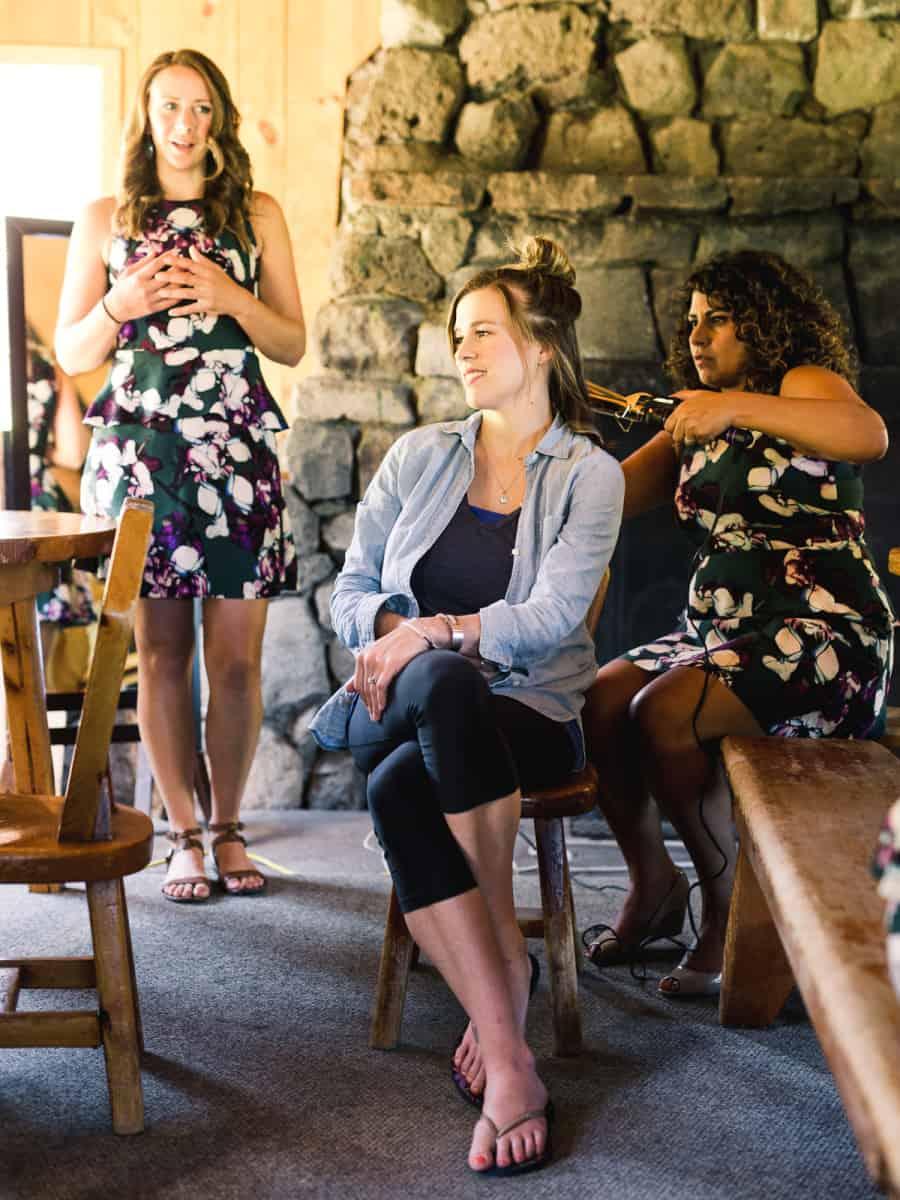 bridesmaids doing hair