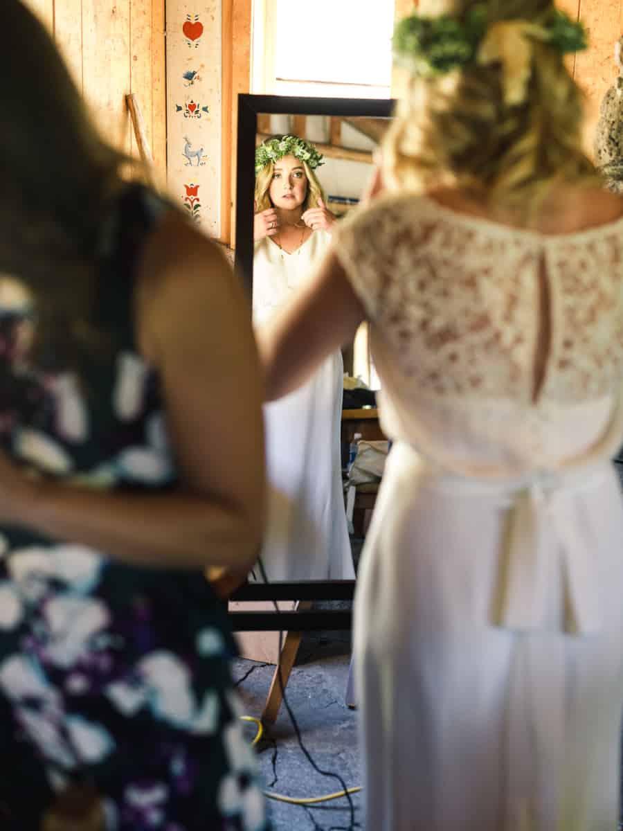 bride looking in mirrot