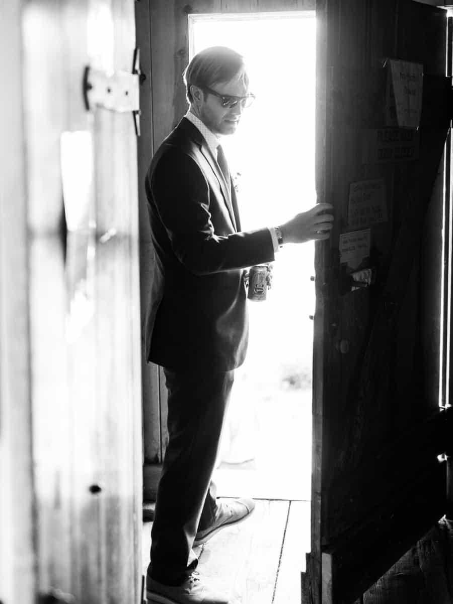 groom in sunglasses going out the door