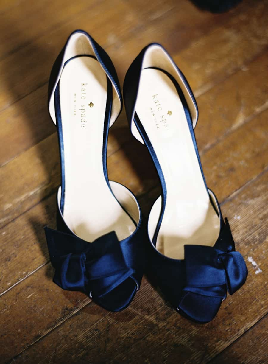 blue kate spade shoes with a blue bow