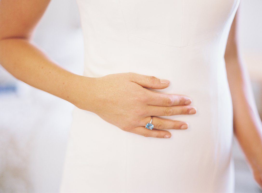 white dress and engagement ring closeup detail