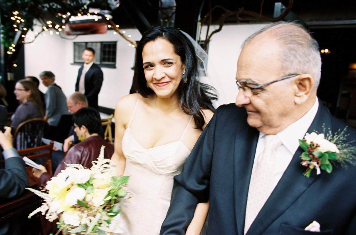 Father and bride walking down aisle